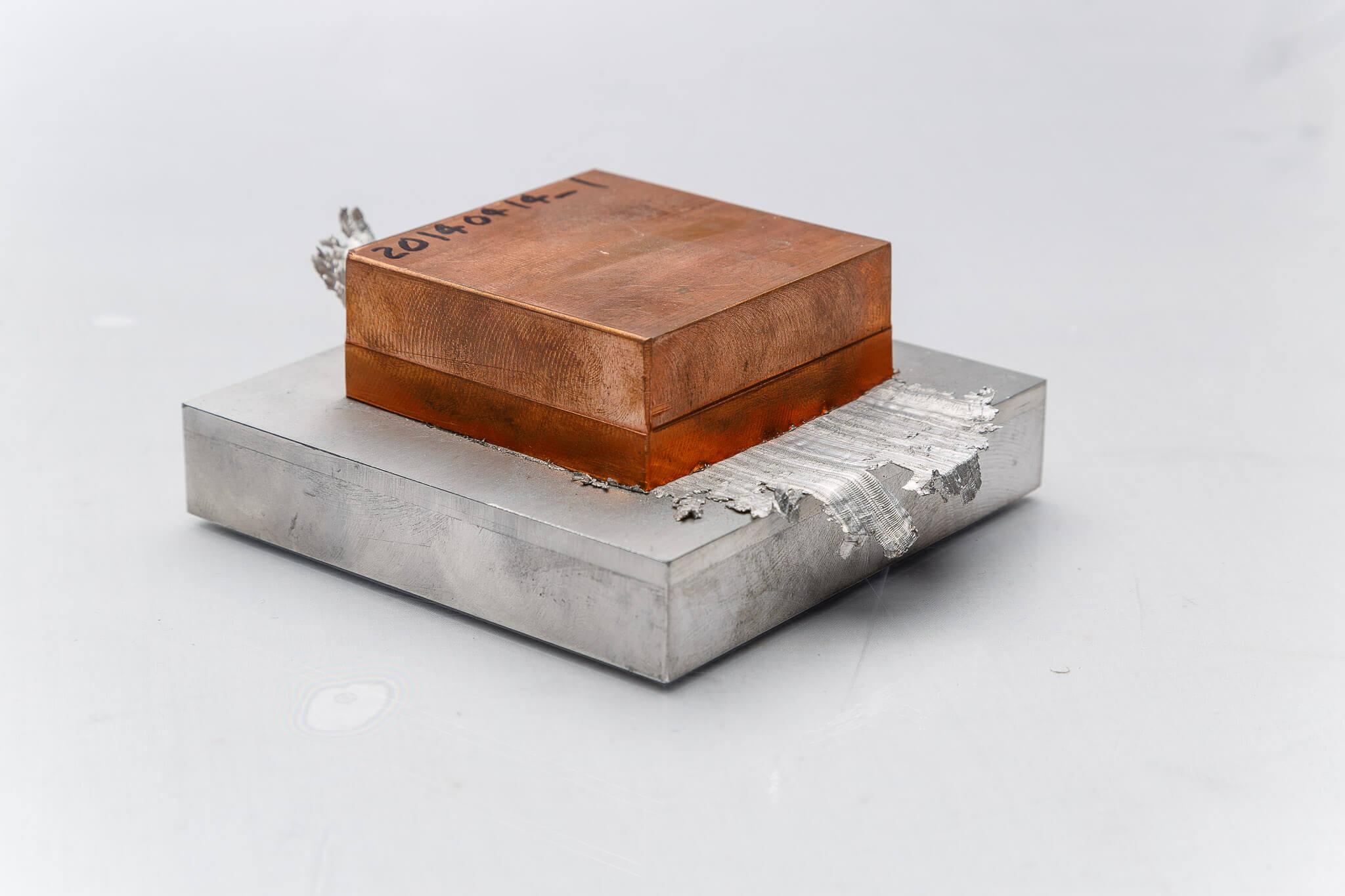 Bi-metallic application linear friction welding of copper alloy block to aluminum plate